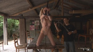 tied up sex slave whipping table bondage
