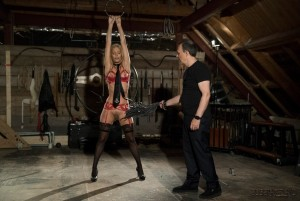Whipping blonde slave